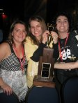 Heather Taft, Mary Katherine Smith, and Ann Mahoney Kadar pose with the Freddie G. trophy.